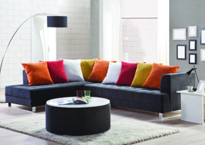 Corner Sofa and scattered cushions